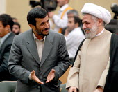 Iranian President Mahmoud Ahmadinejad, left, talks to Sheikh Naim Qassem, deputy leader of Lebanon's Hezbollah, during a religious meeting in Tehran, Iran. - Siavash Habibollahi - 18-08-2007