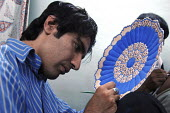 An Iranian worker decorating a plate in his workshop in Isfahan, Iran. June 17, 2008. - Siavash Habibollahi - 17-06-2008