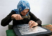 An Iranian woman worker decorating ceramics in a workshop in Isfahan, Iran. June 17, 2008. - Siavash Habibollahi - 17-06-2008
