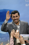 Iranian President Mahmoud Ahmadinejad waves to journalists during press conference at the presidency in Tehran, Iran. - Siavash Habibollahi - 11-12-2007