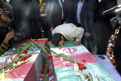 Iran's president Mahmoud Ahmadinejad kisses the coffin during of a funeral ceremony was held to commemorate the deaths of the unidentified soldiers, in Tehran, Iran. Recently recovered bodies of falle... - Siavash Habibollahi - 06-11-2007
