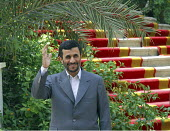 Iran's President Mahmoud Ahmadinejad waves to journalists before an arrival ceremony for his counterpart Nursultan Nazarbayev in Tehran, Iran. - Siavash Habibollahi - 15-10-2007