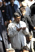 Iran's President Mahmoud Ahmadinejad, and other Muslims attend in Friday Prayers after an anti-Israeli rally marking Al-Quds Day (Jerusalem Day), to support the Palestinian cause, in Tehran, Iran. - Siavash Habibollahi - 05-10-2007