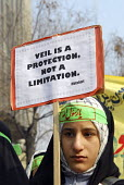 Iranian schoolgirl holds a placard during a silent demonstration in Tehran to promote adherence to Iran's Islamic dress rules. - Siavash Habibollahi - 08-02-2008