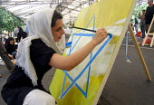 An Iranian woman paints an Israel flag during a painting workshop for resistance of and solidarity with the Palestine people in Tehran, Iran 2007 - Siavash Habibollahi - 06-09-2007