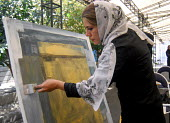 An Iranian woman paints during a painting workshop for resistance of and solidarity with the Palestine people in Tehran, Iran. Sept 6, 2007 - Siavash Habibollahi - 06-09-2007