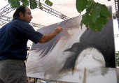 An Iranian man during a painting workshop for resistance of and solidarity with the Palestine people in Tehran, Iran. Sept 6, 2007 - Siavash Habibollahi - 06-09-2007
