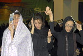 Iranian women hold holy Koran during a religious ceremony to mark the anniversary of the death of the first Shi'ite Muslim Imam, Imam al-Ali, at a grand mosque in Tehran, Iran. Oct 2, 2007. - Siavash Habibollahi - 03-10-2007