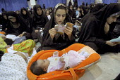 An Iranian female reads holy Koran during a religious ceremony to mark the anniversary of the death of the first Shi'ite Muslim, Imam al-Ali, at a grand mosque in Tehran, Iran. Oct 2, 2007. - Siavash Habibollahi - 02-10-2007