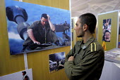 An Iranian soldier looks to a picture of Israeli soldier during a anti -Israeli photo exhabition in Tehran, Iran.Oct 4 , 2007. - Siavash Habibollahi - 02-10-2007