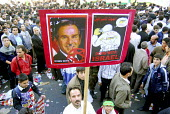 An Iranian man holds up a placard of George Bush and Israel , during a demonstration to commemorate Student Day in front of the old U.S Embassy in Tehran, Iran. It is the anniversary of the takeover o... - Siavash Habibollahi - 04-11-2005