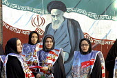 Iranian women standing in front of a mural of Irans late founder Ayatollah Ruhollah Khomeini during a demonstration to commemorate Student Day in front of the old U.S Embassy in Tehran, Iran. It is th... - Siavash Habibollahi - 04-11-2006