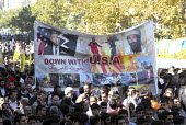 Iranian chant slogans in front of an anti-American banner with Bush and Osama bin Laden, during a demonstration to commemorate Student Day in front of the old U.S Embassy in Tehran, Iran. It is the an... - Siavash Habibollahi - 04-11-2005