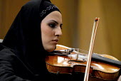An Iranian musician from Iran Orchestra performs during a concert at the 22nd Fajr International Music Festival in Vahdat Hall in Tehran, Iran Jan 2, 2007 - Siavash Habibollahi - 01-01-2007