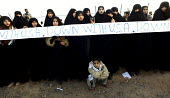 Thousands of Iranians form a human chain around the Natanz uranium enrichment facility during a rally to show support for the country's nuclear program, in Natanz, 350 km (217 miles) south of the capi... - Siavash Habibollahi - 18-11-2005