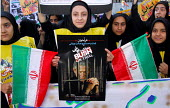 An Iranian girl holds an ANTI-Bush poster during a demonstration in front of the former U.S. Embassy in Tehran, Iran. - Siavash Habibollahi - 21-11-2007