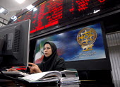 An Iranian stock market employee works in Tehran's stock market in Tehran, Iran. - Siavash Habibollahi - ,2000s,2007,Business,dealing,dress,ebf,Economic,economy,employee,employees,Employment,FEMALE,hajib,headscarf,hijab,Iranian,ISLAM,ISLAMIC,job,jobs,LAB,LBR,market,markets,monotheistic,MUSLEM,muslim,musl