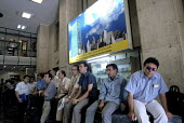 Iranian share holders look at electronic display boards in Tehran's stock market in Tehran, Iran. - Siavash Habibollahi - 04-08-2007