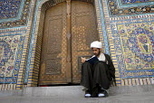 An Iranian clergyman student reads islamic book and practice at the Faizieh school in Qom city, Iran. - Siavash Habibollahi - 31-05-2007