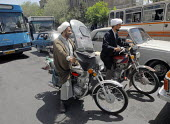 Iranian clergymen are among many who ride motorcycles in Qom city, Iran. - Siavash Habibollahi - 2000s,2007,bike,bikes,cities,city,EBF,EBF Economy,Economic,Economy,holy site,Imam,Imams,Iranian,iranians,islam,Islamic,male,man,men,monotheistic,mosque,mosques,motorbike,MOTORBIKES,motorcycle,motorcyc