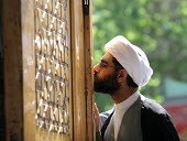 An Iranian clergyman pays his respect to Hazrat Masumeh (SA) Holy shrine in Qom city, Iran. - Siavash Habibollahi - 26-04-2007