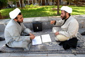 Two Iranian clergymen discuss islamic book and religious subjects at the Faizieh school in Qom city, Iran. - Siavash Habibollahi - 31-05-2007