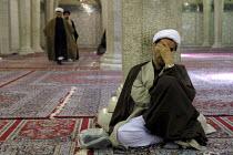 An Iranian clergyman listens to a master at the Faizieh school in Qom city, Iran. - Siavash Habibollahi - 31-05-2007