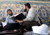 Iranian clergymen students read islamic books and discuss at the Faizieh school in Qom city, Iran. - Siavash Habibollahi - 31-05-2007