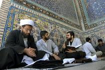 Iranian clergymen students read islamic books and discuss at the Faizieh school in Qom city, Iran. - Siavash Habibollahi - 31-05-2007
