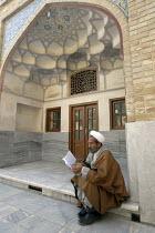 An Afghan clergyman student reads an islamic book at the Faizieh school in Qom city, Iran. - Siavash Habibollahi - 31-05-2007