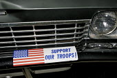 American flag appears on car bumper sticker - support our troops. New Jersey, USA. - Steven Langdon - 2000s,2007,America,American,americans,AUTO,AUTOMOBILE,AUTOMOBILES,AUTOMOTIVE,car,cars,flag,flags,patriot,patriotism,pol politics American,scene,scenes,stars and stripes,sticker,stickers,street,streets