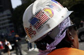 Construction worker at Ground Zero. New York has sticker on hard hat: I didn't forget I don't forgive - 9-11-01. Depicts American flag . New York, USA. - Steven Langdon - 2000s,2008,9/11,African American,African Americans,America,American,americans,BAME,BAMEs,black,BME,bmes,cities,city,Construction Industry,diversity,ethnic,ethnicity,flag,flags,hat,hats,job,jobs,LAB LB