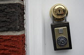 A house listed as Foreclosure & Public Auction in central Philadelphia, USA. Access to property via a lock box key. - Steven Langdon - 2000s,2008,Access,America,Auction,AUCTIONS,BUY,buyer,buyers,buying,commodities,commodity,Credit Crunch,debt,debts,door,doors,DOWNTURN,EBF,Economic,Economy,eviction,evictions,financial crisis,For Sale,