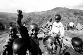 Refugee children from the D.R Congo playing around a water station on a hill, Kiziba camp, Kibuye, Rwanda. The provision of clean drinking water prevents water borne disease. - Steven Langdon - 03-08-2003