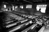 Interior of church which was the scene of mass killings during the genocide of 1994 of Tutsis by Hutu militia. Small holes in the roof were made when grenades were used. Victims clothes and artifacts... - Steven Langdon - 03-08-2003