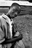 Two refugee children from Burundi embrace in a camp near Kibuye, Rwanda, 2003 - Steven Langdon - 03-08-2003