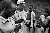 Young refugees from the D.R Congo at the camp near Byumba with calculators to give them a better understanding of numbers. Rwanda, 2003 - Steven Langdon - 03-08-2003