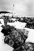 Snow surrounds the graves of Muslims massacred at Racak, in 1999. Kosovo 2004 - Steven Langdon - 2000s,2004,BALKAN,balkans,BAME,BAMEs,BME,bmes,cemeteries,cemetery,conflict,conflicts,diversity,ethnic,Ethnic Cleansing,ethnicity,eu,europe,european,europeans,former,grave,graves,Graveyard,Graveyards,i