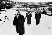 Three women mourners leave the burial site of those who were murdered in the Racak massacre in 1999 of 45 Albanians by Serb military forces. Racak, Kosovo, 2004 - Steven Langdon - 2000s,2004,armed forces,Balkan,balkans,BAME,BAMEs,BME,bmes,burial,conflict,conflicts,diversity,ethnic,Ethnic Cleansing,ethnicity,eu,europe,european,europeans,FEMALE,former,islam,ISLAMIC,kosova,KOSOVAN