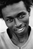 A young man from Somalia whose family are seeking asylum in Holland at an asylum reception centre, Dronten. Netherlands, 2005 - Steven Langdon - 03-10-2005