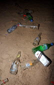 Bottles and cans litter the beach. Summer Night in Newquay, Towan Beach, Newquay, Cornwall - Sam Morgan Moore - 09-08-2003