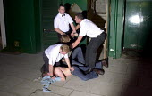 Bouncers outside nightclub, bank holiday weekend Newquay 2003 - Sam Morgan Moore - 20-06-2003