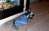 Drunk man on pavement, Newquay Cornwall - Sam Morgan Moore - 09-08-2003