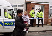 Police anti-terrorist raids in Sparkbrook Birmingham Local residents pass Police in Sparkhill after raids to foil an alledged terrorist plot. Birmingham. - Stalingrad O'Neill - 2000s,2007,Act,adult,adults,against,anti,Anti Terrorist Unit,asian,BAME,BAMEs,Birmingham,black,BME,bmes,child,CHILDHOOD,children,cities,city,CLJ,communities,community,DAD,DADDIES,DADDY,DADS,diversity,