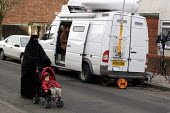 Police anti-terrorist raids in Sparkbrook Birmingham Local residents pass Media outside broadcast van in Sparkhill after raids to foil an alledged terrorist plot. Birmingham. - Stalingrad O'Neill - 2000s,2007,Act,adult,adults,against,anti,Anti Terrorist Unit,asian,BAME,BAMEs,Birmingham,black,BME,bmes,broadcast,BROADCASTING,burka,burkas,burqa,burqas,cities,city,communicating,communication,communi