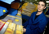 Male worker packing Virgin Atlantic airline bags at Remploy, Barking - Janina Struk - 2000,2000s,BAG,bags,cities,city,disabilities,disability,disable,disabled,disablement,incapacity,job,jobs,LAB LBR work,male,minorities,needs,packing,people,Remploy,social,special,urban,worker,workers,w