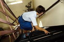 Woman cleaner at Brighton Post office - Janina Struk - 06-06-1998