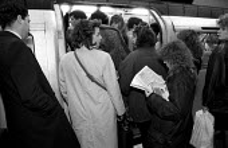 Crowded London underground tube train - Janina Struk - 1990s,1997,adult,adults,cities,city,COMMUTE,commuter,commuters,commuting,Crowd,Crowded,crowding,crowds,EBF economy,FEMALE,from work,job,jobs,journey,journey to,journeys,LAB LBR work,lfl,LIFE,lifestyle
