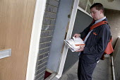Starburst team postman delivering post on a north Peckham housing estate - Janina Struk - 01-06-2002