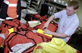 Postman, member of a starburst team, loading mail bags at Camberwell sorting office - Janina Struk - 01-06-2002